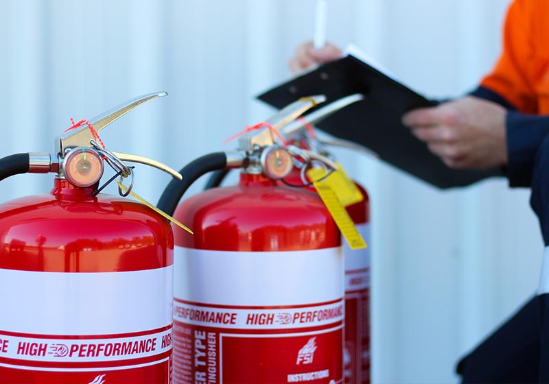 Male testing extinguishers